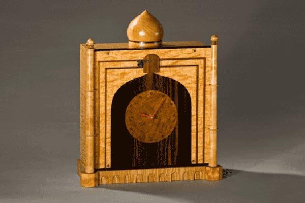 Baby Taj wall clock. Quilted maple, curly maple, macassar ebony, elm burl, black walnut. 14″h x 13″w x 5'd