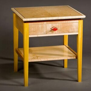 Deco style bedside table with drawer: Curly maple, birdseye maple, pau amarolo, red paint, bubinga inlay. 20″ w x 18″ d x 22″ h