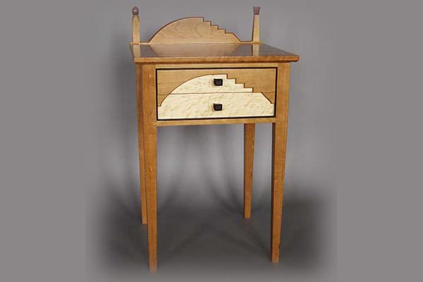 California bedside table: Cherry, bird's eye maple, rosewood trim and handles. 26″ h x 20″ l x 19″ d