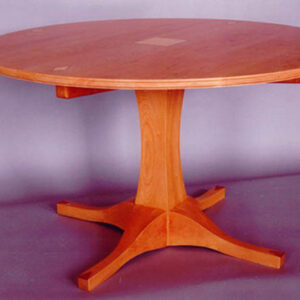 Solid cherry table; It's got legs! Curly maple and bubinga inlays 52″ diameter 30″ h .