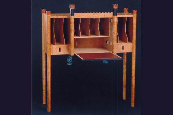 Desk with  Steel cable suspension. 50″ w x 50″ h x 18.5″ d  with the door in open position.