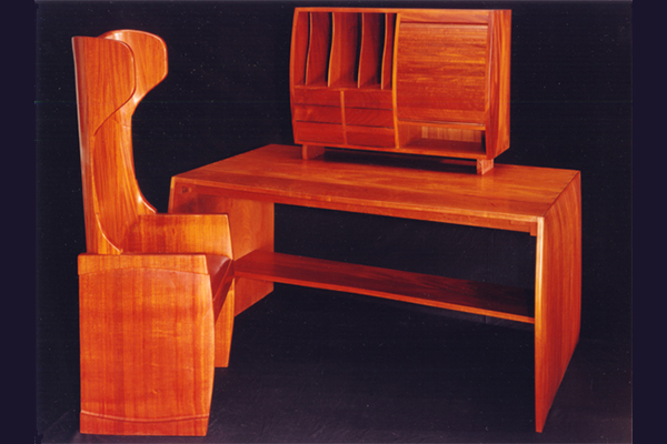 Mahogany desk and chair. Coopered + contoured chair back, shaped sides for cabinet, desk and chair 51″ w x 62″ h 26″ d