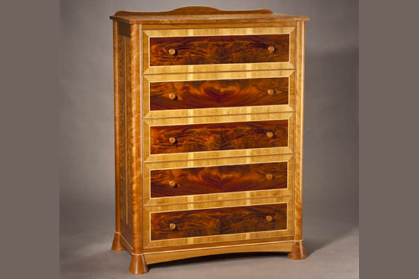 Five drawer bureau: Butt matched crotch mahogany, curly cherry, maple inlay,pearwood handles 40″ W x 54″ H x 20 1/2″ D