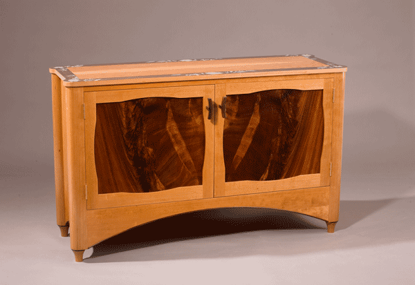 Flower credenza: Crotch mahogany panels, curly cherry qtd., cherry, ebony detail, hand painted border. 52″l x 16.5″d x 30″h