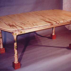 Dining table: This lovely table seats six to ten people. Made of worm hole maple, curly maple, pearwood feet with hand-painted grape vines.