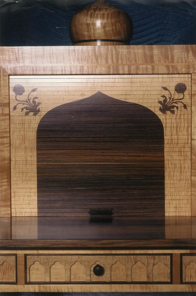 Inspired by India's Taj Mahal, this roll-top desk is made of curly maple, pau ferro, rosewood accents, marquetry tambour, with turned domes 52″ w x 50″ h x 26″ d