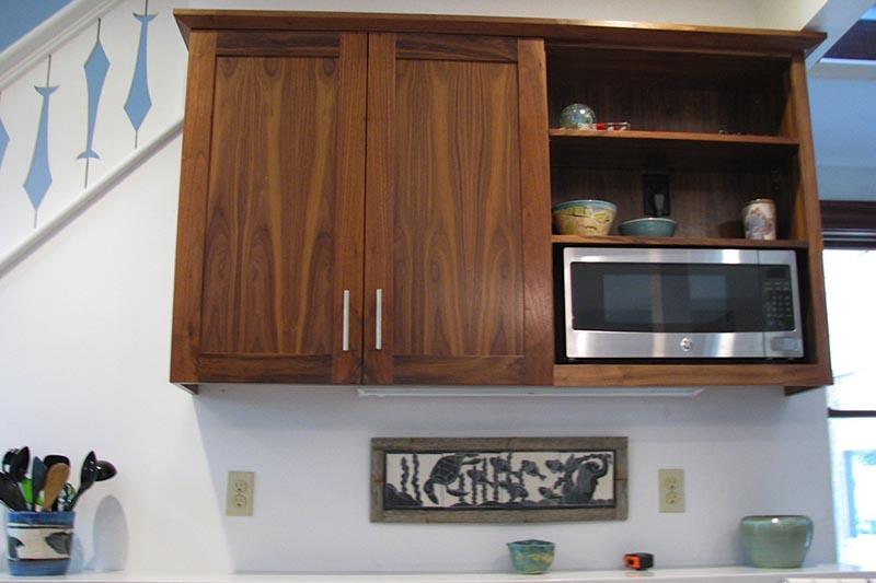 Black walnut kitchen cabinets.