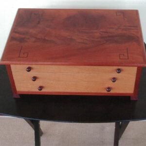 Jewelry Box of Mahogany and lacewood.