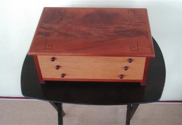 Jewelry Box of Mahogany and lacewood.