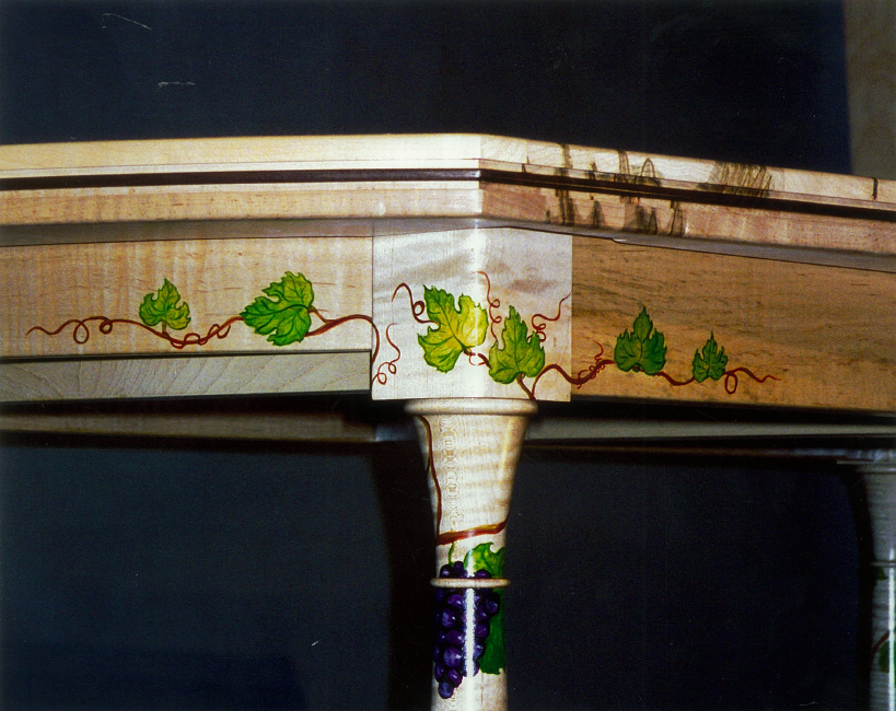 Detail of dining table with painted leaves