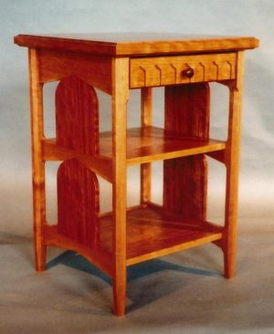 Bedside table: Quilted cherry, cherry, bubinga, hand dovetailed and fitted drawer. 26″ h x 20″ w x 20″ l